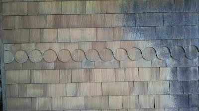 Redwood siding on home Before-After
